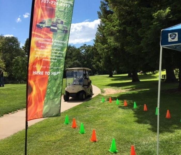 This image shows a golf cart and our SERVPRO flag at a recent golf tournament