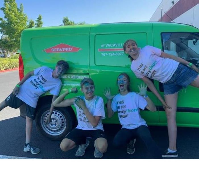 This photo shows 4 teenagers full of chalk after their Fun Run at school