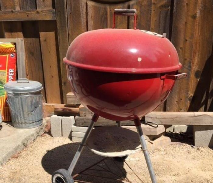 This is a picture of a red barbeque